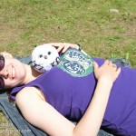 Linnea relaxing with Owlette in her new Celtic cat tank top.